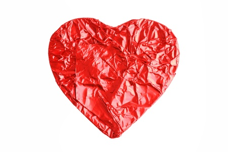 Figured in the form of candy hearts, wrapped in foil on a white background photo