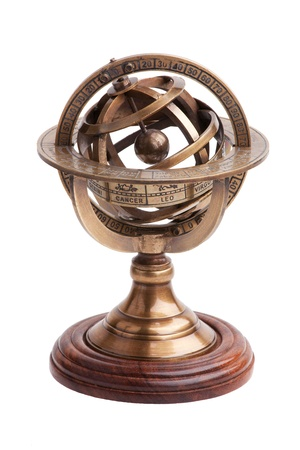 Antique brass armillary sphere on a wooden stand on a white background