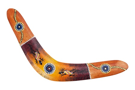 Wooden boomerang pattern decorated with lizards on a white background Stock Photo