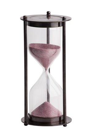 Hourglass with the sand in a brass case on white background