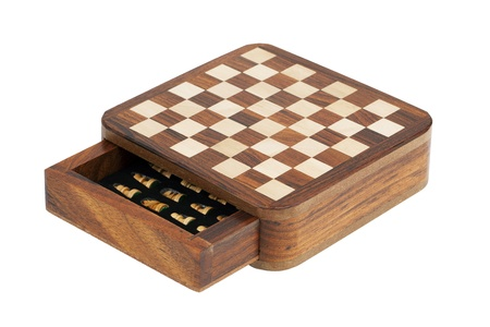 Portable pocket chess board on a white background photo