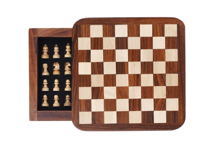 portative: Board with a little pocket chess on white background Stock Photo