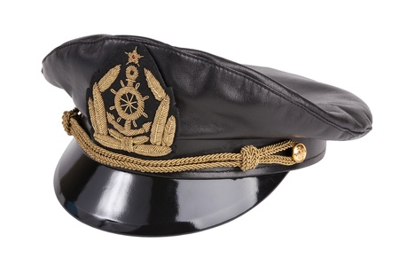 Black navy cap with the golden emblem of an anchor on a white background photo