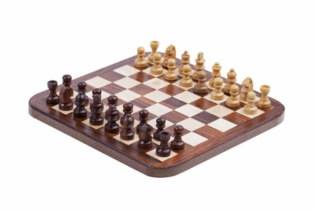 Board with pocket chess on white background photo