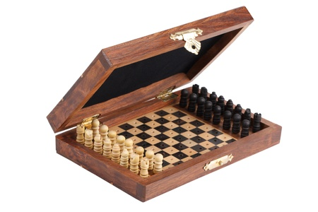 Pocket chess, folded into a box on  white background photo