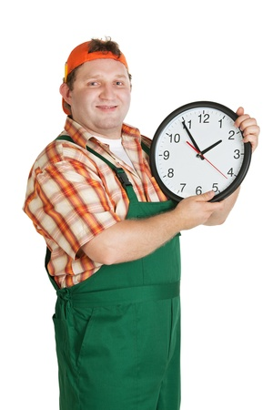 Cheerful worker with a big clock in the hands of a white background photo