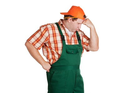 cogitate: Worker dressed in overall about something meditating
