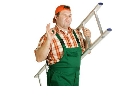 Cheerful worker in overalls with a ladder winking eye photo