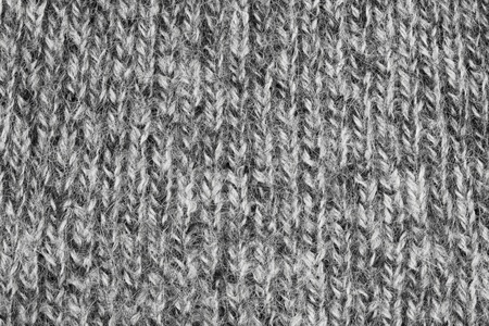 villi: Fragment of knitting wool sweater gray-white