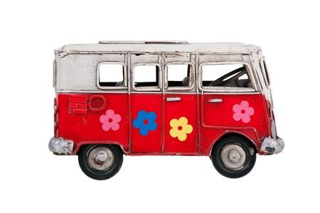 motorbus: Juguete colorido bus de metal sobre un fondo blanco Foto de archivo