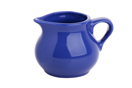 wineglass: Small elegant clay jug of milk on white background Stock Photo