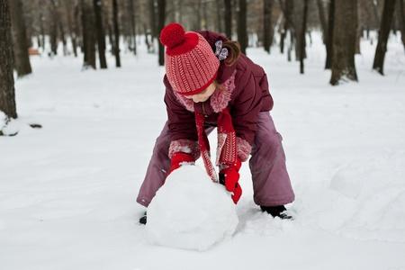 varmint: The little girl was lying a snowman in winter