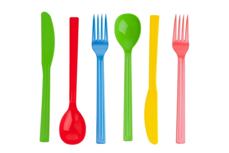 Disposable fork, spoon and knife on a white background