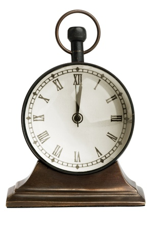 Antique bronze table clock on a white background Stock Photo