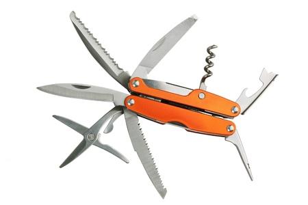 portative: Serie di strumenti di Orange come coltelli, forbici, cavatappi, apriscatole e la lama punteruolo Archivio Fotografico