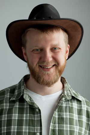 granger: The good-natured cowboy hat and a green plaid shirt Stock Photo