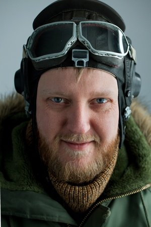 Young polar pilot in alaska green jacket and flying helmet Stock Photo - 12199765