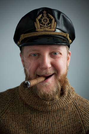 Seaman with a smoking cigar, knit sweater and cap