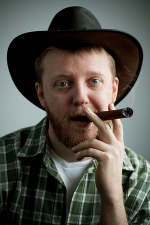 granger: Red-bearded man in a cowboy hat and a shirt with a cigar in his mouth