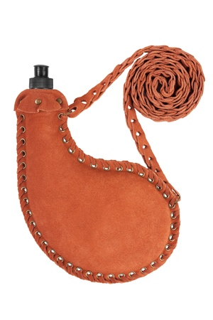 The metal flask in a leather case on the belt wicker photo