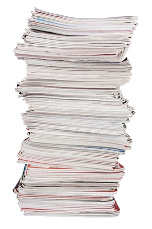 The high stack of old magazines on white background