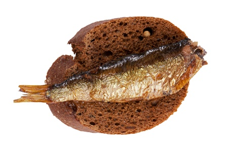 Smoked fish on a slice of rye bread photo