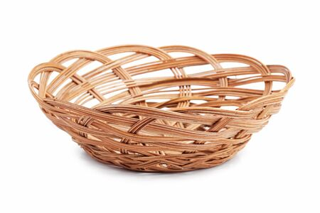 Wicker basket of bread or fruit on a white background photo