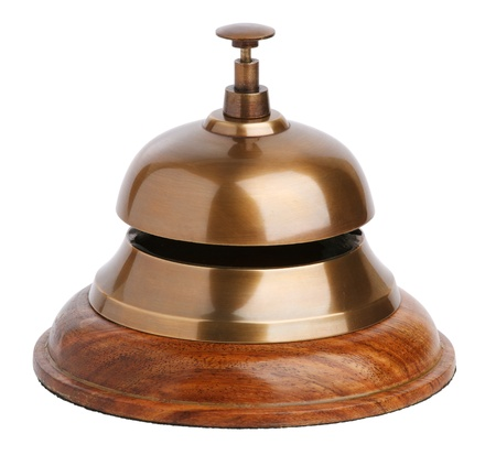 evoke: Antique brass bell with a button on white background