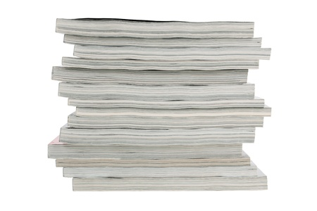 Stack of old magazines unnecessary on a white background photo