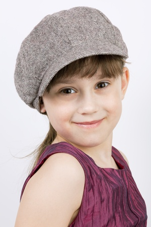 varmint: Smiling girl with long hair in a gray cap