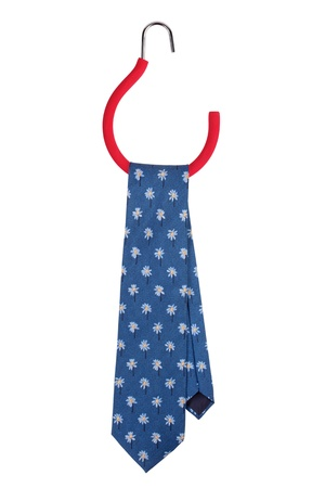 neckcloth: Blue tie hanging on a special hanger Stock Photo