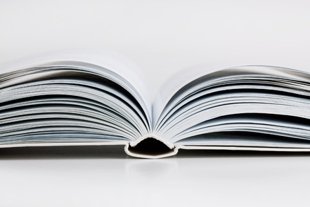 Pages open a thick book on white background Standard-Bild