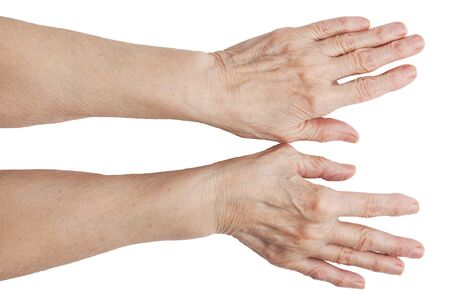 The hands of an old man on a white background Stock Photo