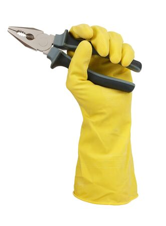Hand in yellow glove holding a pair of pliers on white background photo