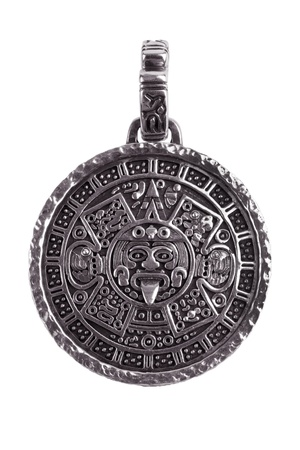 Pendant engraved with the Mayan calendar on a white background photo