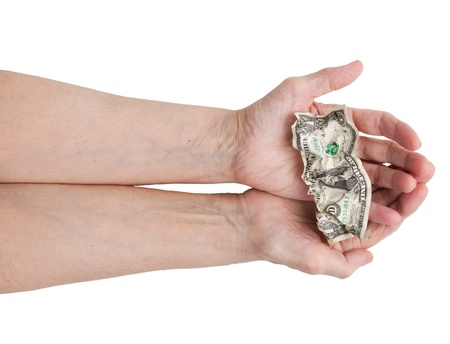 Dollar bill in his hands on a white background photo