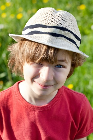 Ruffled the boy in a hat sunny spring day Stock Photo - 13665610