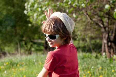 Lucky boy has fun summer sunny day photo