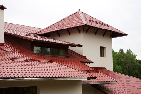 Roof of the house, lined with red roof tiles Stock Photo - 13777189