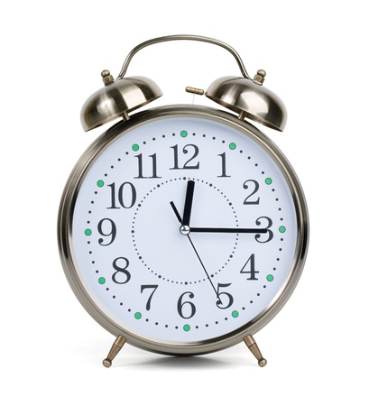 Alarm clock in a metal case on a white background Stock Photo - 14084961