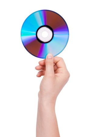 Mans hand holding a compact disc on  white background