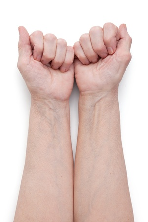 tendons: Hands of an elderly man, short of a fist on  white background Stock Photo