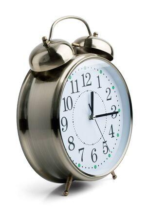 wakening: Round alarm clock in a metal case on white background