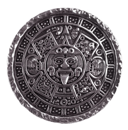 Medallion engraved with the Mayan calendar on a white background Stock Photo