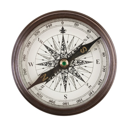Antique compass in a brass case on  white background photo