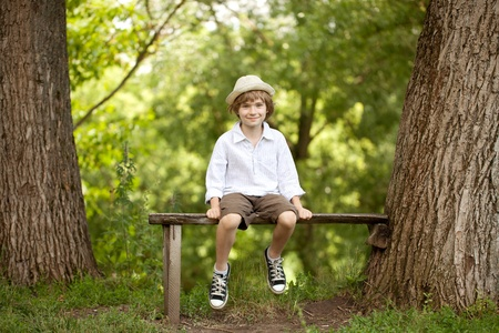 varmint: Little boy in a hat, shorts and sneakers