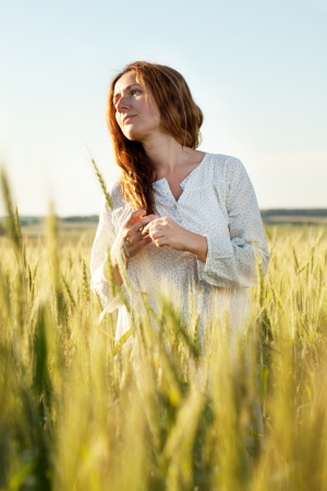 goodliness: Woman with her hair down the middle of a wheat field