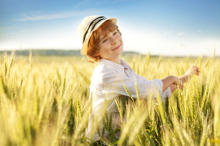 blessedness: Happy boy with a hat in the middle of wheat fields Stock Photo