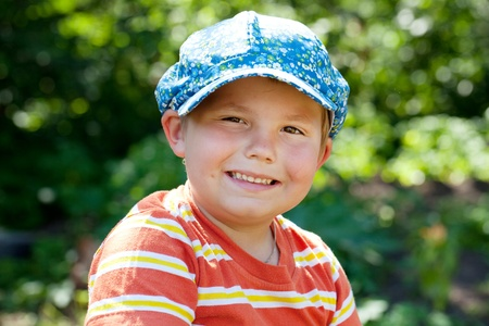 blithe: Cheerful boy in a cap and striped shirt