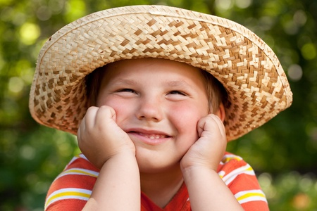 blithe: Boy in a straw hat dreaming of something